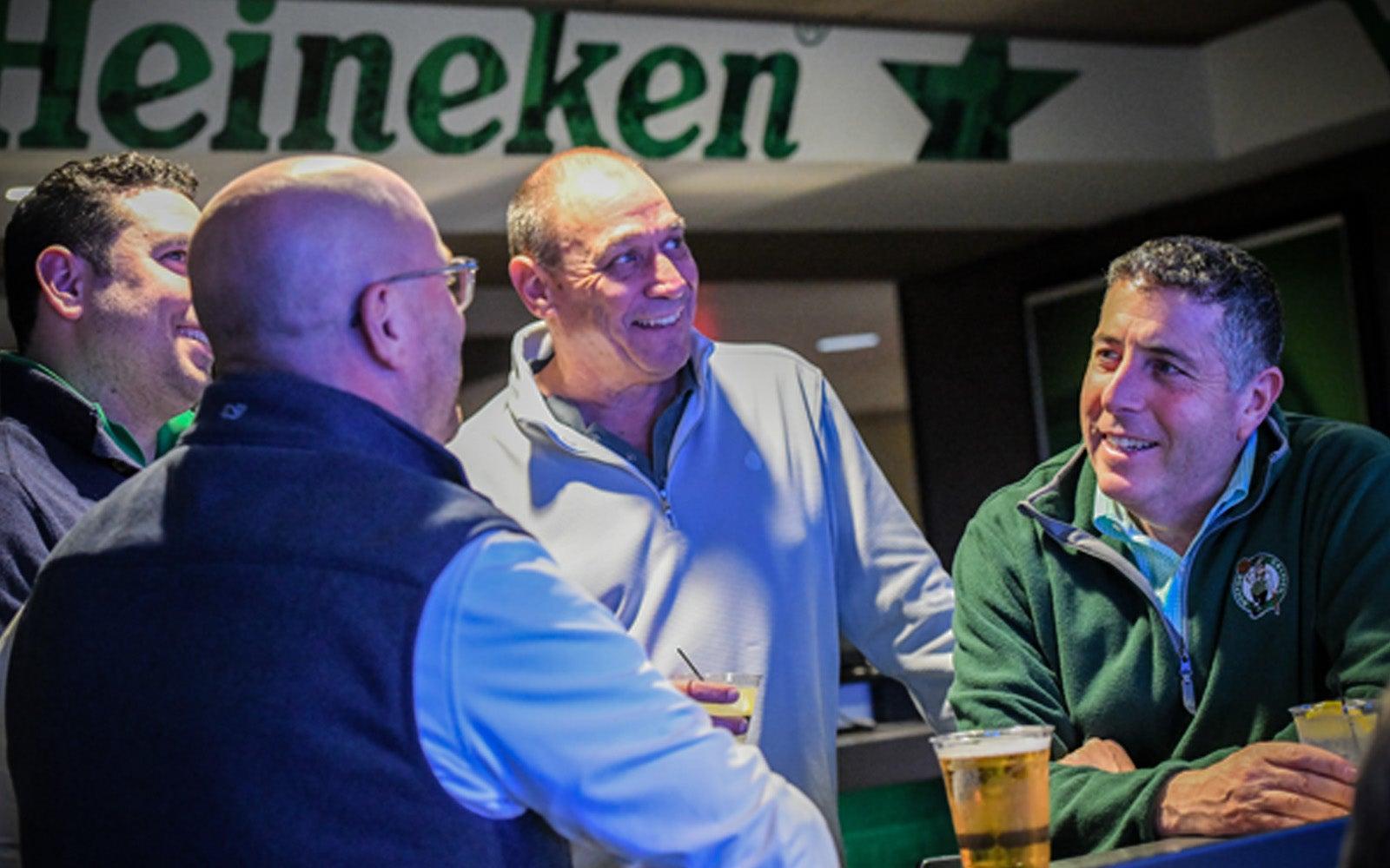 Image of fans talking in the Heineken green room